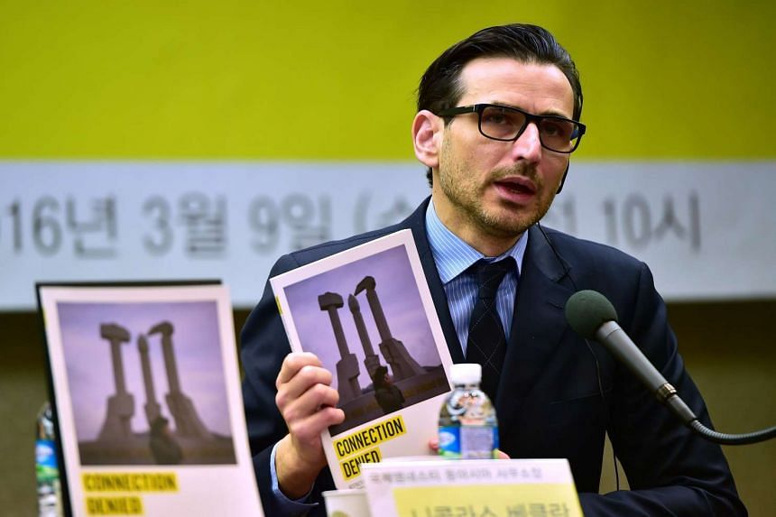 Amnesty East Asia regional director Nicholas Bequelin speaking during a press conference on restrictions on mobile phones and outside information in North Korea, in Seoul on March 9, 2016.  North Korea is cracking down on the private use of mobile p