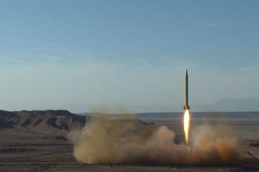 A ballistic missile is launched and tested in an undisclosed location, Iran, in this handout photo released by the official website of Islamic Revolutionary Guard Corps (IRGC) on March 8, 2016.