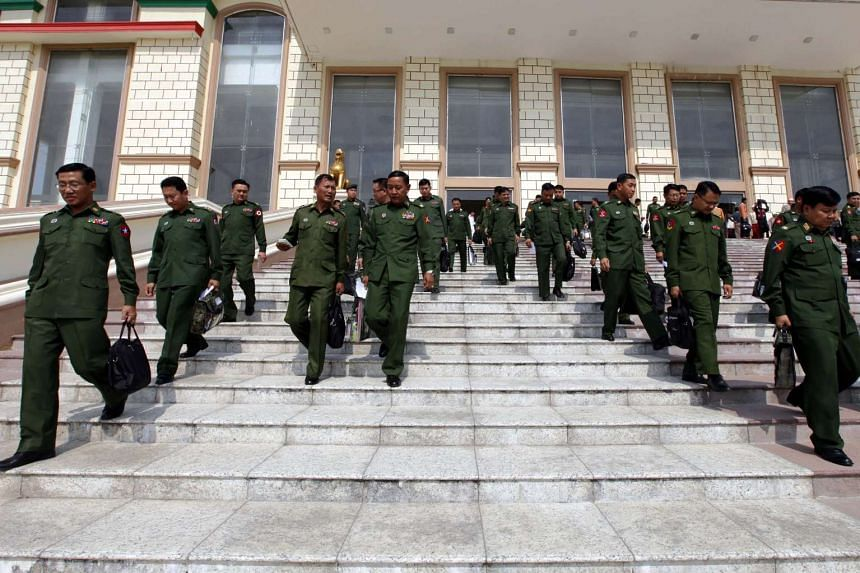 Military representatives of parliament leave after a regular parliament session in Naypyitaw on March 1, 2016.