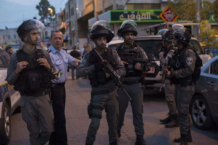 Israeli special police secures the area around a shooting attack at Salah al-Din Street in East Jerusalem on March 8, 2016.