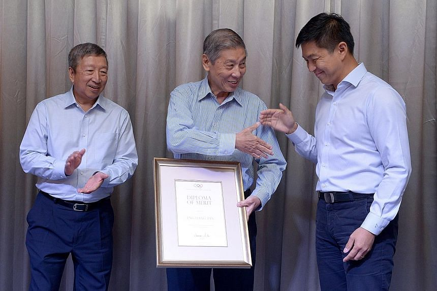 (Left) SNOC secretary- general Chris Chan and Singapore's first Olympic medallist Tan Howe Liang with SNOC president Tan Chuan-Jin after receiving their awards at the ceremony last night. (Top) SNOC vice-president Tan Eng Liang, who also received the