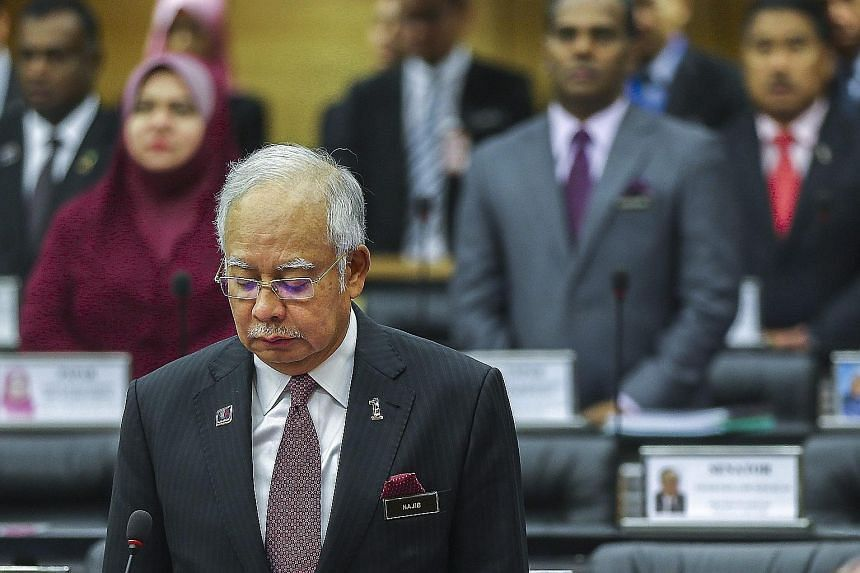 Malaysian PM Najib Razak in Kuala Lumpur yesterday observing a moment of silence to mark the second year since the disappearance of Flight MH370.