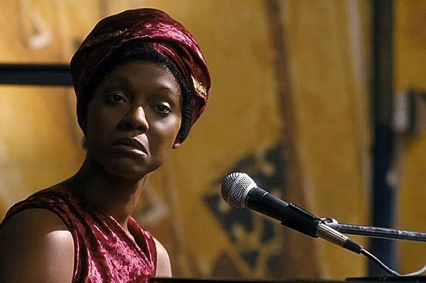 Zoe Saldana (above) plays the legendary soul singer Nina Simone in decline.