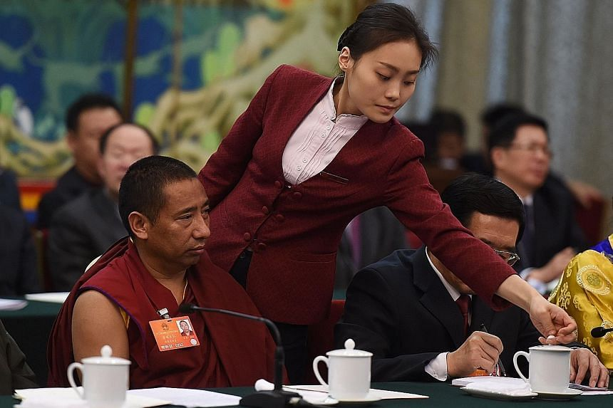 A Tibetan delegate at a meeting at the National People's Congress, China's annual legislative meeting, in Beijing on Monday.