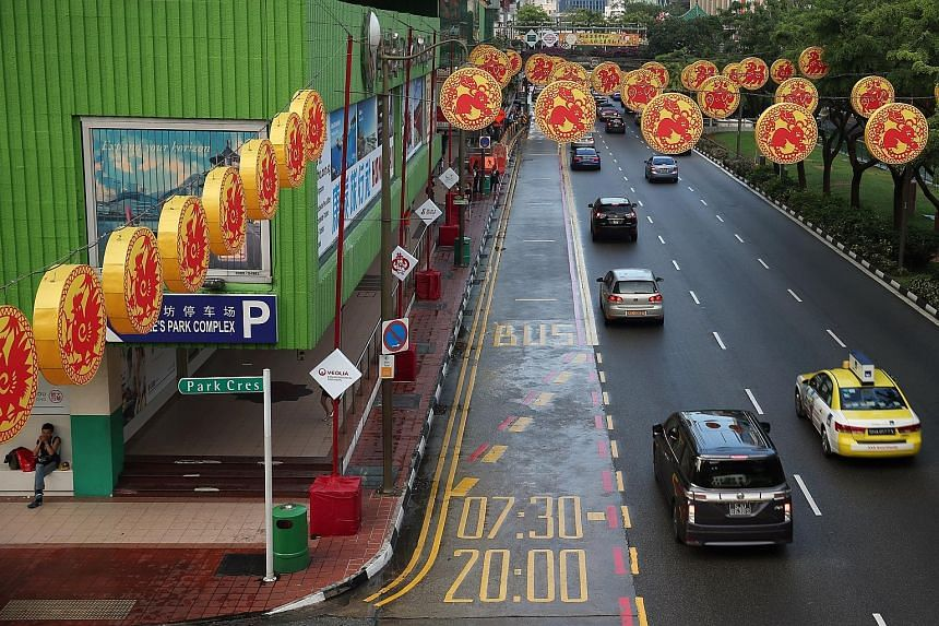 From March 21, full-day bus lanes, like this one located in Eu Tong Sen Street, will be in operation till 11pm.