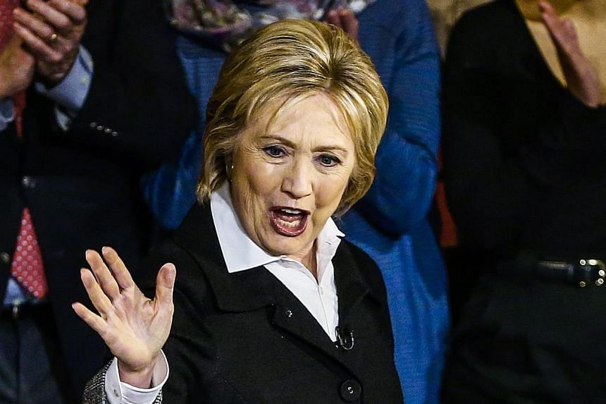 Mrs Hillary Clinton on stage at a town hall meeting in Detroit, Michigan, on Monday. She is leading Mr Sanders by almost 200 pledged delegates won in earlier primaries and caucuses.