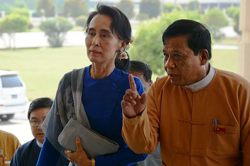 Ms Suu Kyi and NLD senior leader Zaw Myint Maun arriving at the Parliament in Naypyitaw last Tuesday. Three names will be proposed in Parliament for the office of President tomorrow.