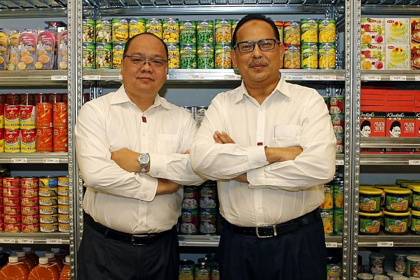 My Outlets president Ronnie Tan (far left) with Mr Malek, the chief executive. The company assists emerging SMEs in the halal food industry to expand and grow.