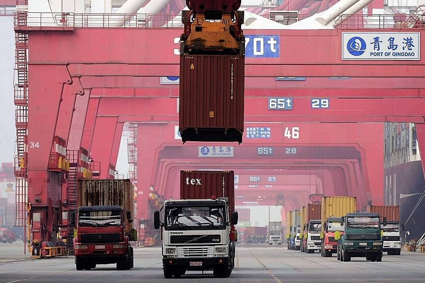 Port operations in Qingdao, Shandong province. China's trade performance in February was far worse than expected.