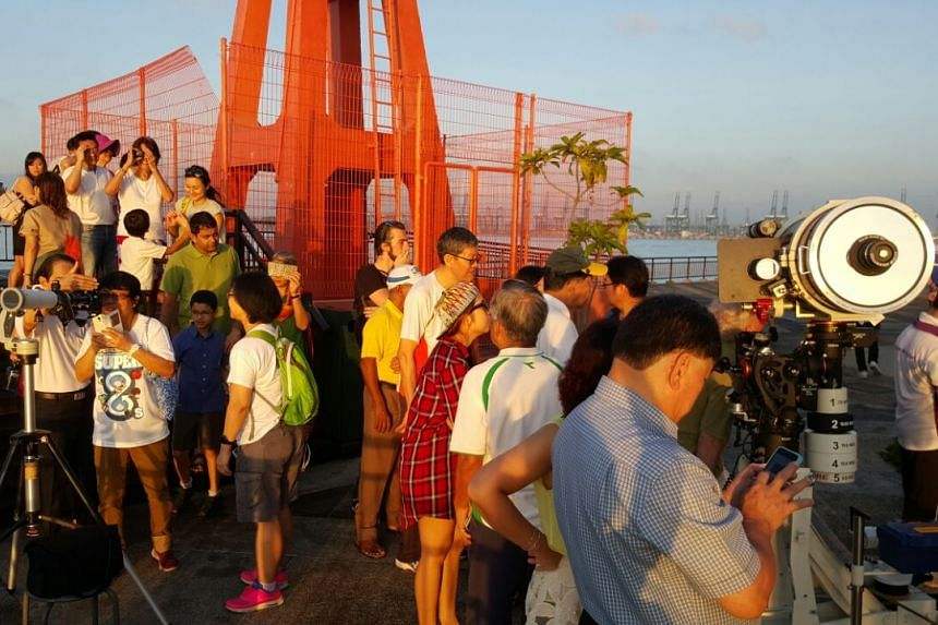 The crowd queuing to use the telescope to see the solar eclipse at Labrador Park in Singapore.