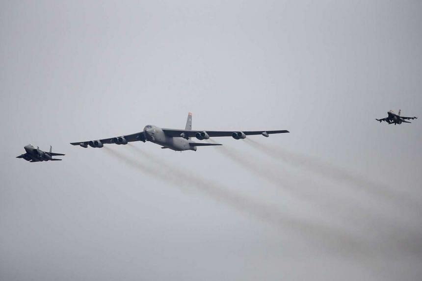 A US Air Force B-52 (centre) flying over Osan Air Base in Pyeongtaek, South Korea, on Jan 10, 2016.