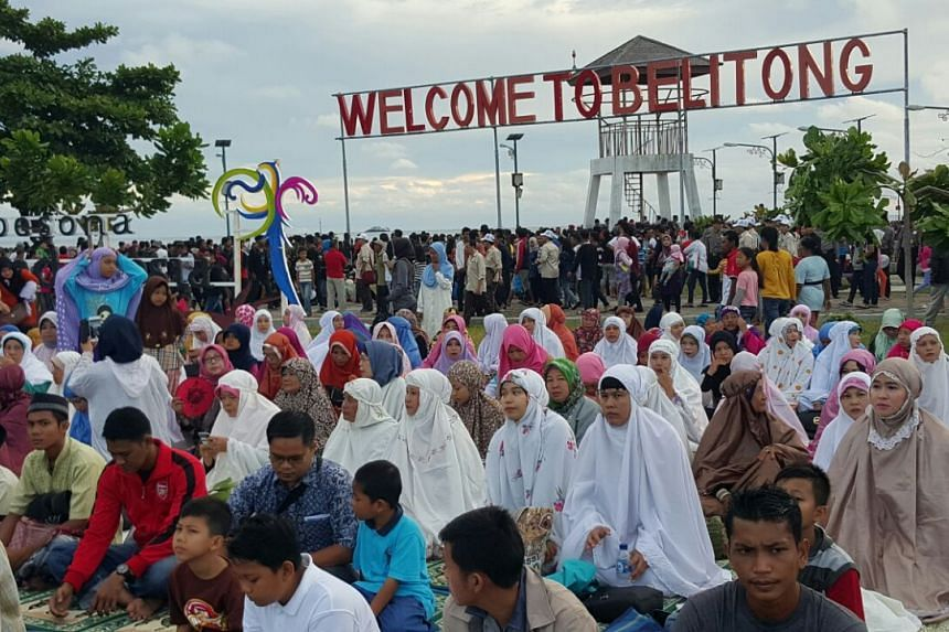 """Muslims gathering on the beach to take part in special """"total eclipse prayers""""."""