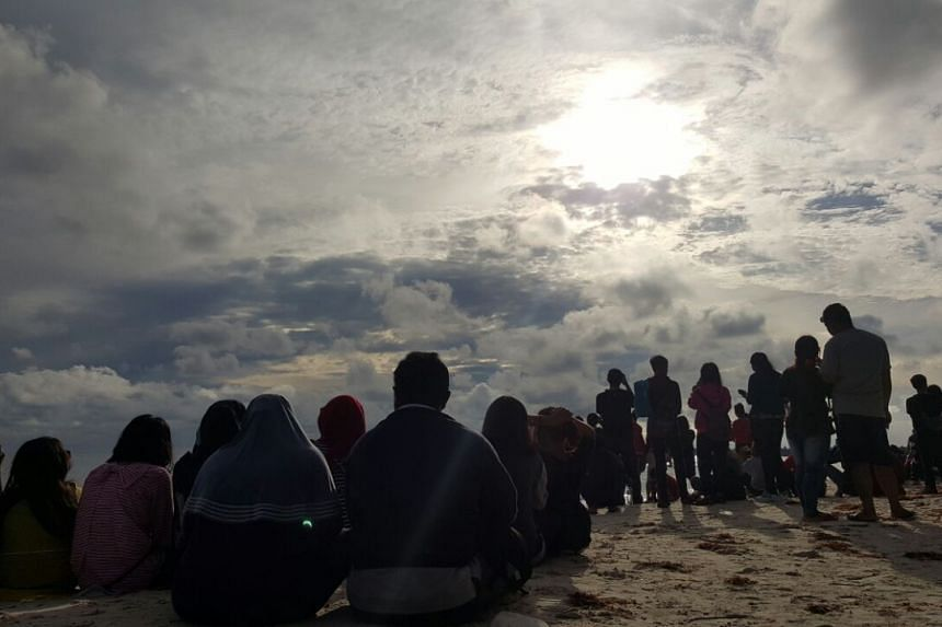 The sky turning dark at Belitung's Tanjung Kelayang beach in anticipation of the total solar eclipse.