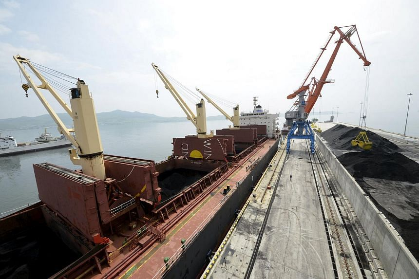 A cargo ship is loaded with coal at the North Korean port of Rajin in this July 18, 2014 file photo.