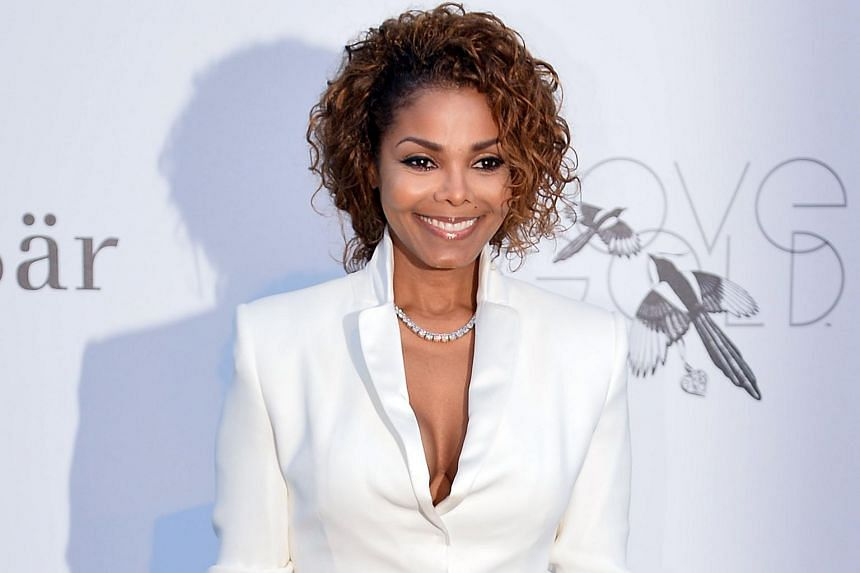 US singer Janet Jackson posing as she arrives for the amfAR's 20th Annual Cinema Against Aids on May 23, 2013.