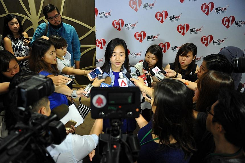NDP2016 Logo Designer, Lim Xin Chelsea, 19, speaking to the media.
