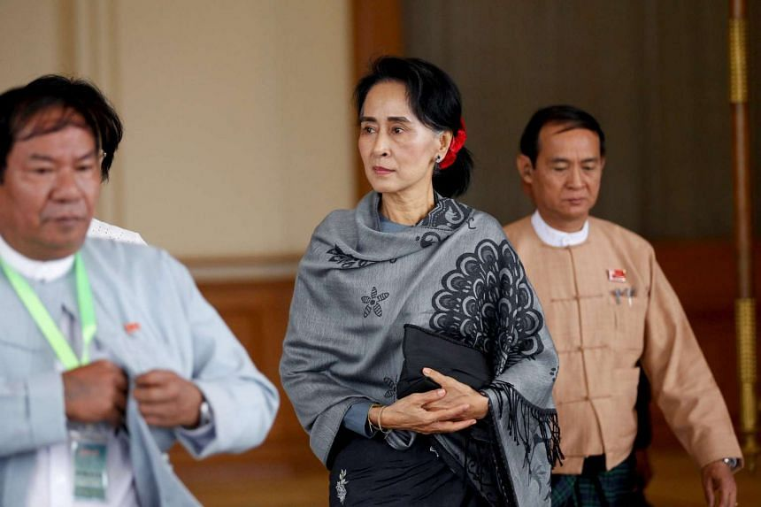 Aung San Suu Kyi's (centre) incoming government is rethinking a controversial Chinese-backed dam in Myanmar.