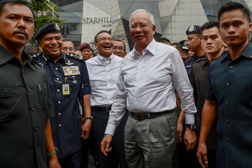 Malaysia's Prime Minister Najib Razak (centre, right) arriving during a joint police-army exercise at a shopping mall in Kuala Lumpur on Feb 22, 2016.