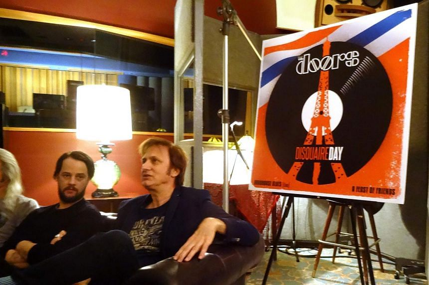 Michael Kurtz (right), co-founder of Record Store Day, and Lee Foster (left), manager of Electric Lady Studios, sitting next to a poster advertising a special release by The Doors during a news conference on March 8, 2016.