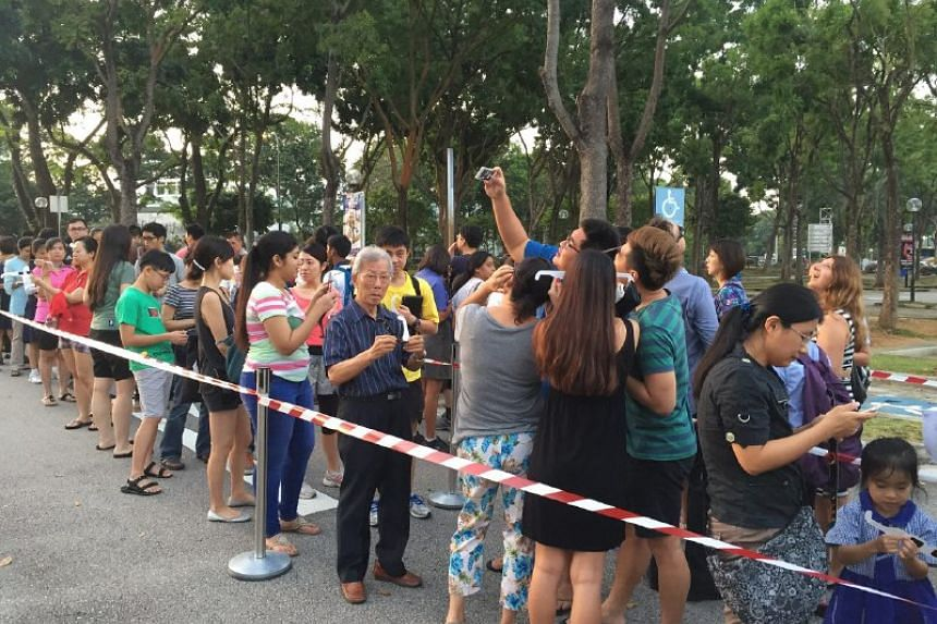 People queuing for telescopes at the Science Centre in Singapore.