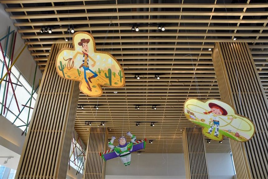Traditional Chinese-style kites decorate the interior of the Sunnyside Cafe inside the Toy Story Hotel.