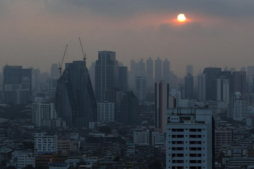 A partial solar eclipse is seen in Bangkok, Thailand, on March 9, 2016.