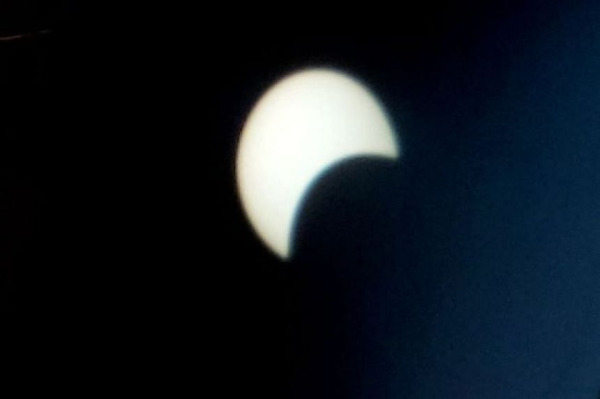 The solar eclipse as seen in Kota Kinabalu in this photo by Normimie Diun.