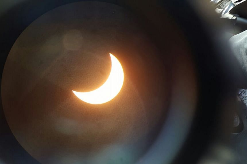 Photo of the eclipse from a telescope at the Labrador Park in Singapore at around 8am.
