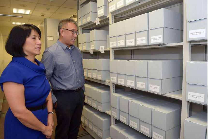 ( Above )Ms Chew Gek Hiang and Mr Chew Kwee San, council members of the Tan Chin Tuan Foundation, with the boxes containing Mr Tan's private papers. They will be available to the public in the next three months. Banker and philanthropist Tan Chin Tuan was