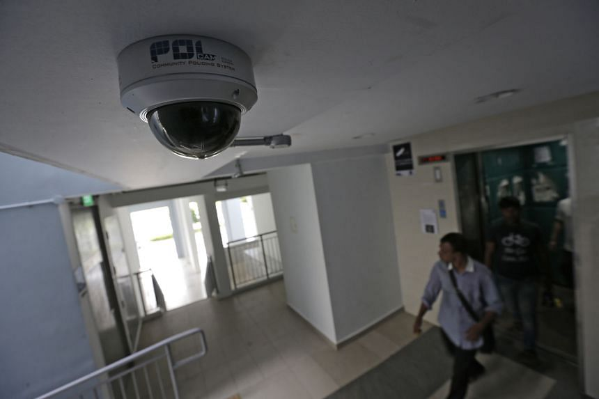 A security camera at a lift lobby in a Pasir Ris housing estate. Footage from police cameras has led to the arrests of unlicensed moneylenders in 360 cases of harassment since 2012.