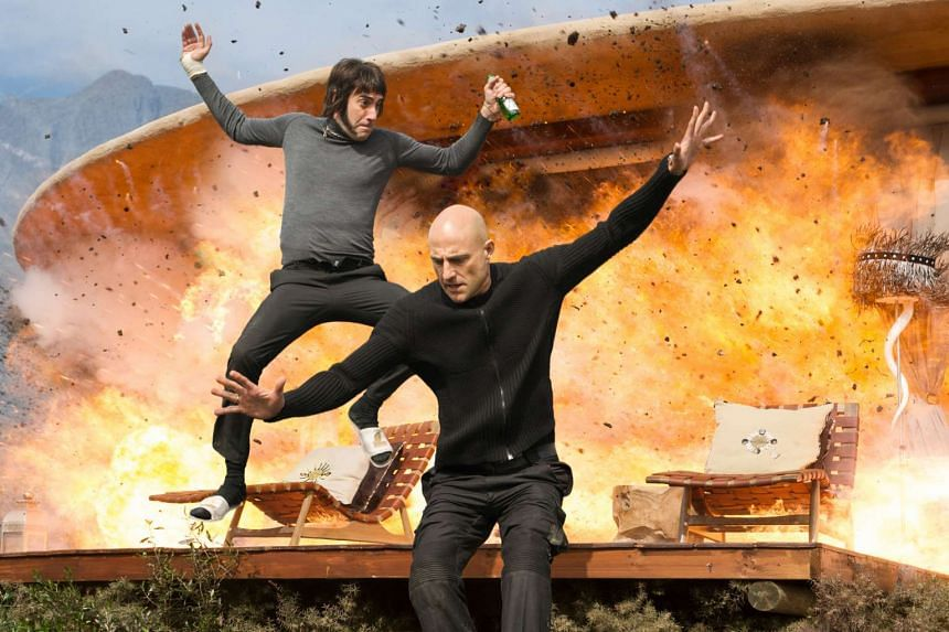 Sacha Baron Cohen (far left) and Mark Strong as brothers in The Brothers Grimsby.
