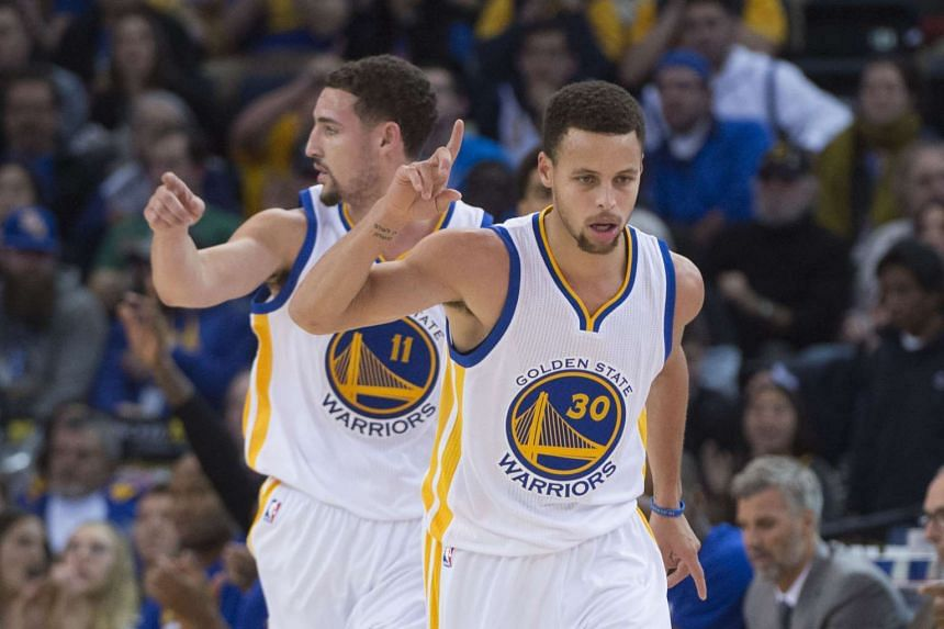 Golden State Warriors guards Klay Thompson (left) and Stephen Curry combined for eight three-pointers in the 115-94 win over the Utah Jazz.