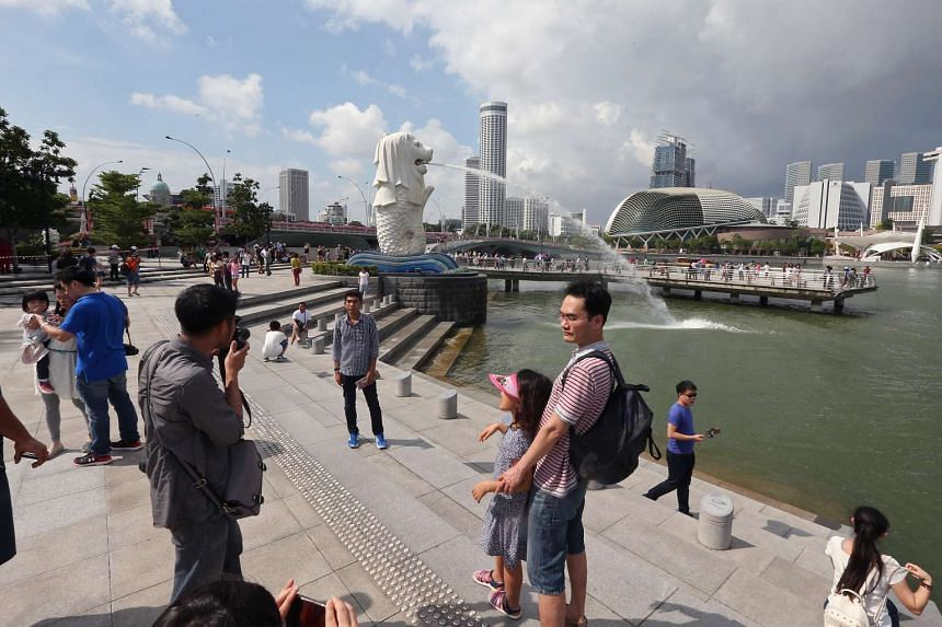 Members of the public taking photographs at the Merlion Park on Feb 18, 2016.