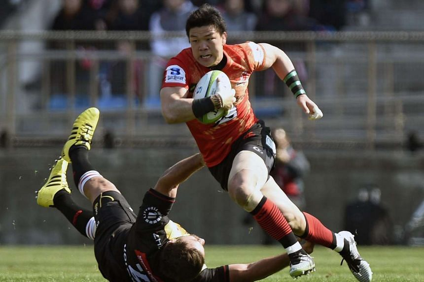 Harumichi Tatekawa (right) of the Sunwolves powers past Robbie Coetzee of the Lions during their Super Rugby opener in Tokyo on Feb 27, 2016.