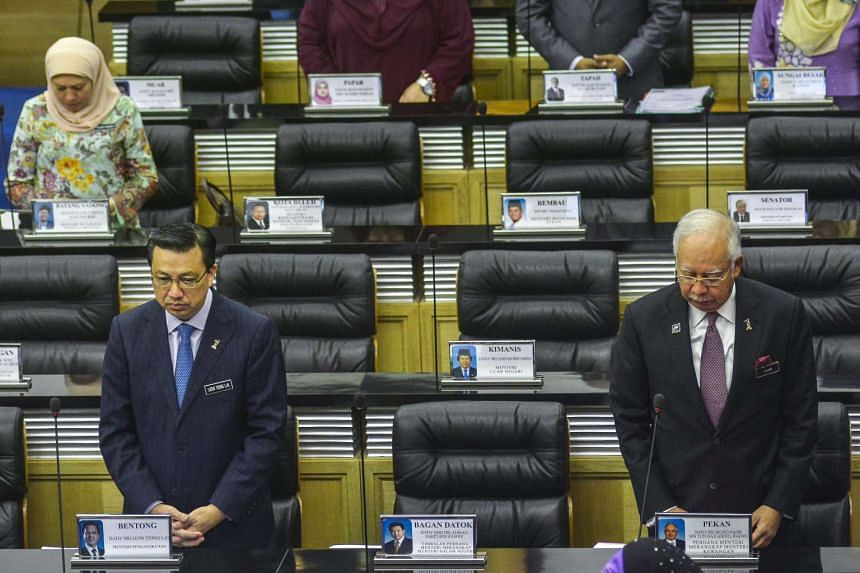 Malaysian Prime Minister Najib Razak (right) and Transport Minister Liow Tiong Lai observing a moment of silence to mark the second year since the disappearance of Malaysia Airlines flight MH370, at the Parliament in Kuala Lumpur, Malaysia, on March