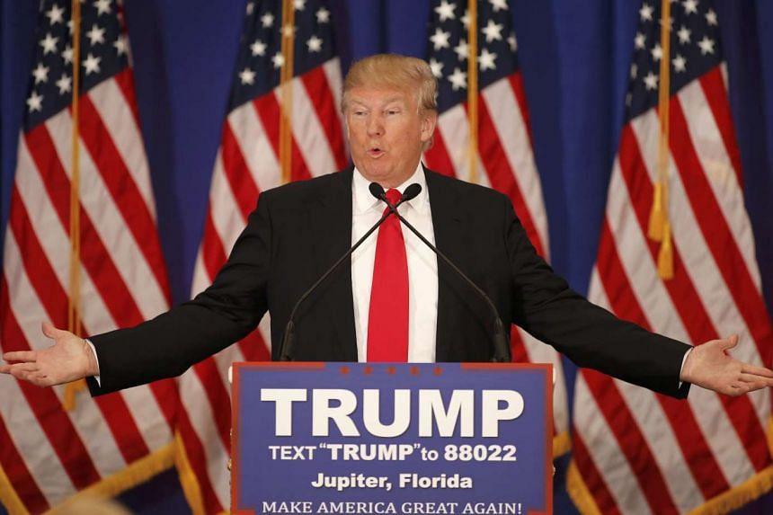 Donald Trump speaks about the results of the Michigan, Mississippi and other primary elections during a news conference.