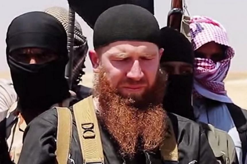 Abu Omar al-Shishani (centre) is believed to have been badly wounded but not killed in a US air strike.