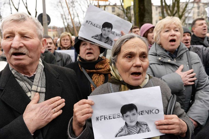 Activists in support of jailed pilot Nadiya Savchenko outside the Russian consulate in Lviv, western Ukraine, on March 9, 2016.