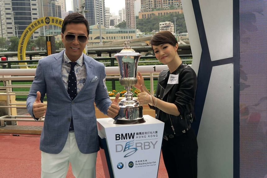 Donnie Yen (left) and his sister Chris Yen at the Hong Kong Derby on March 9, 2016.