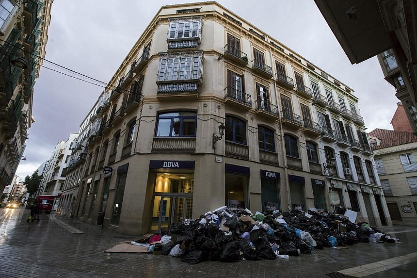 A pile of garbage is seen outside a building in downtown Malaga, Spain, on March 10, 2016.