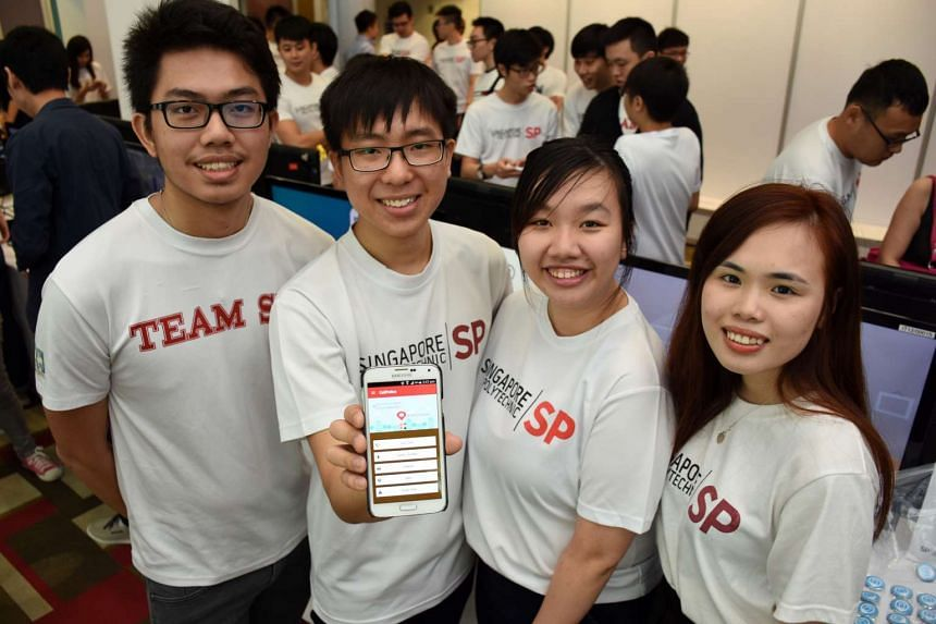From left: Deswanto, 20, Nicolas Wee, 19, Claris Tham, 20, and Lee Wei Yan, 20, with their mobile app, Call Police.