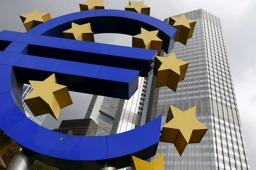 The euro logo sculpture stands in front of the headquarters of the European Central Bank in Frankfurt in this Oct 26, 2014 file photo.