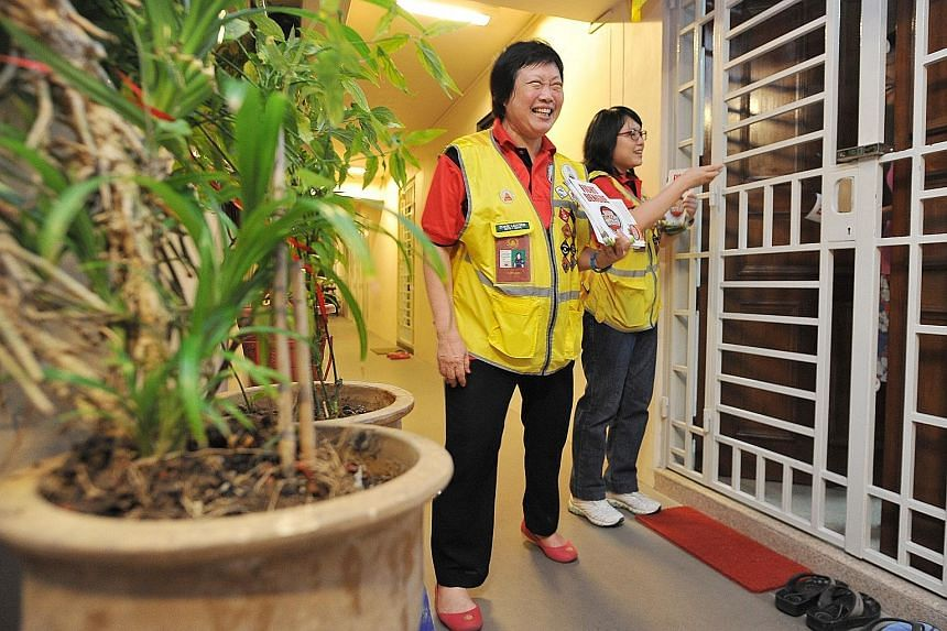 The mother and daughter having a friendly conversation with Mr Mook Woon Kun, 68, a resident of Compassvale Street, while passing him fliers on dengue prevention. The hope is that people will be more receptive to such volunteers, who are neighbourhoo