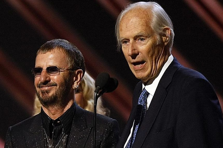 Producer George Martin (left) and former Beatles drummer Ringo Starr receive the trophy for Best Compilation Soundtrack Album at the Grammy Awards in Los Angeles in 2008.