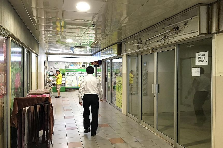 A year ago, there were no vacancies at long-established player People's Park Centre. Today, shops there have closed, like those on this upper floor, and even in the basement, where the popular eateries are.