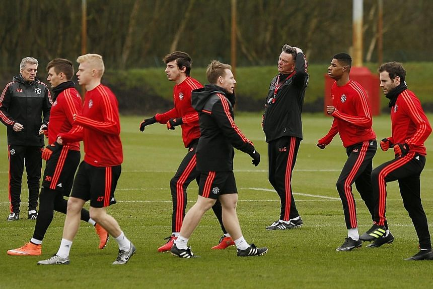 Manchester United manager Louis van Gaal observing his players training yesterday. He admitted as much that the club's glory days were over.