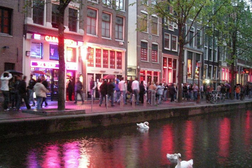 Dutch authorities closed down a notorious Amsterdam hookah bar on Wednesday after a severed human head was discovered at its entrance, a grisly find believed to be linked to a drug war between rival gangs.