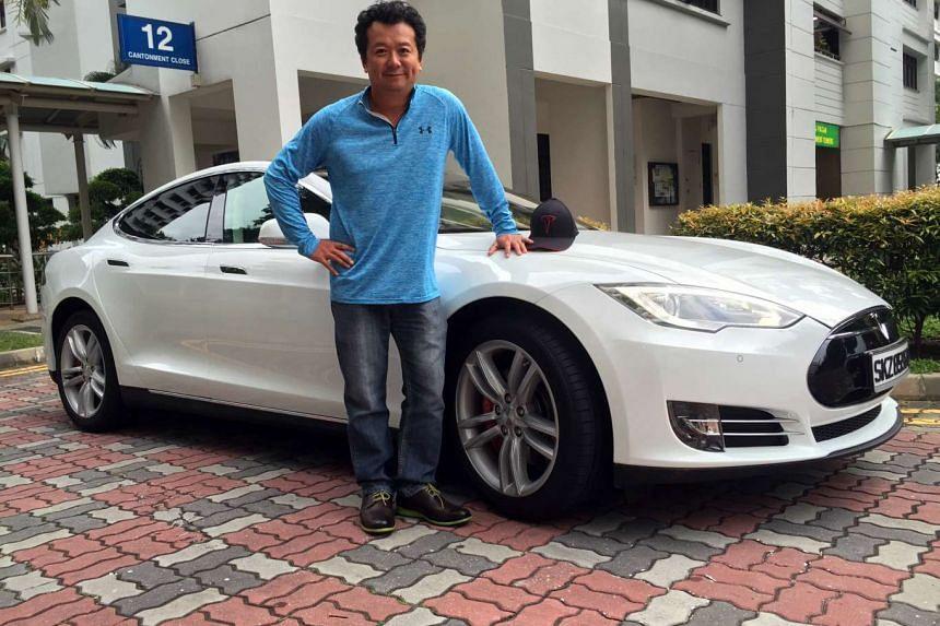 Mr Joe Nguyen with his Tesla Model S.