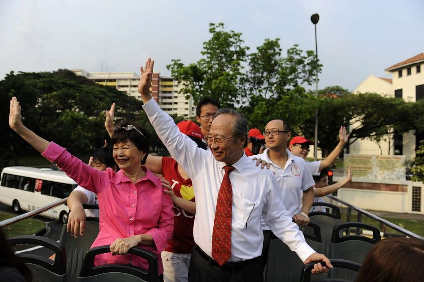 Dr Tan Cheng Bock and wife Cecilia Lee Choon Lain waving to supporters from their open-top bus on 3 September 2011.