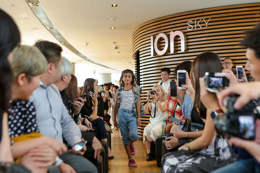 A young model wears Israeli label FOX Kids & Baby at a fashion show preview during a press conference, on March 10, 2016, for Samsung Fashion Steps Out 2016.